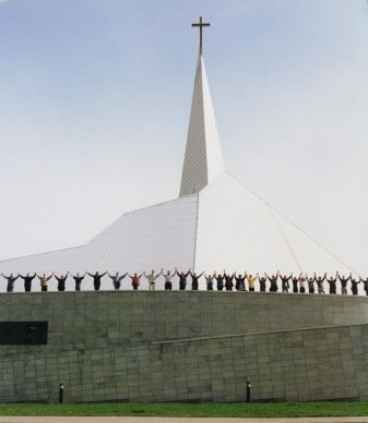 Worshipers rejoice in front of the Baltic Mission Center in Tallinn, Estonia, in this undated file photograph. Methodists from around the world formally opened and dedicated the Center in 2000 as a place of worship and teaching.