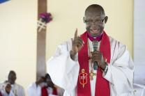 Bishop John K. Yambasu speaks on the Ebola virus during a service of dedication at Valunia United Methodist Church outside Bo, Sierra Leone.