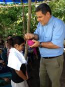 The Rev. Juan Guerrero baptizes a child in Honduras. Photo courtesy of the Rev. Juan Guerrero