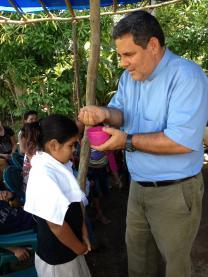 The Rev. Juan Guerrero baptizes a child in Honduras. Photo courtesy of the Rev. Juan Guerrero