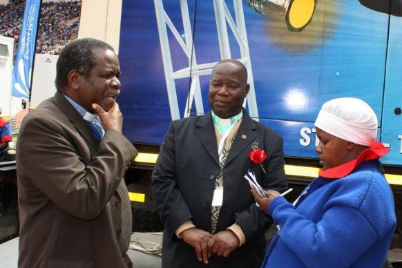 (From left)  The Rev. Jairios Mafondokoto  and the  Rev. Kelvin Mwandira are interviewed by  Eveline Chikwanah  at Ebenezer Convention. Photo by Ray Mungomez