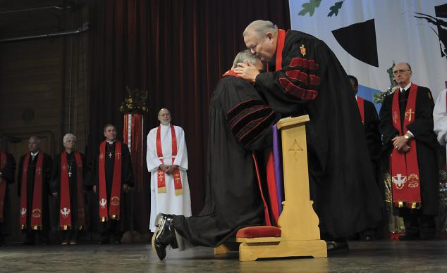 Retired United Methodist Bishop Marion Edwards kisses newly elected Bishop Paul Leeland during the Service of Consecration July 19 at Lake Junaluska, N.C. A UMNS photo By Bill Norton.