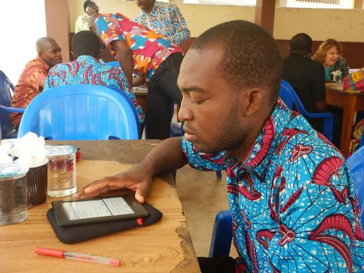 Dja Serge studies an e-reader during the Feb. 7 workshop held at Methodist University in Codody, Abidjan, Cote d'Ivoire.