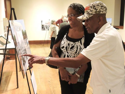 "Cheryl and William J. Claybrooks Sr. look at McCormack's photos during an exhibit at the library ""Because of You: An Evening of Photography and Literature Commemorating Nashville's Civil Rights Movement."""