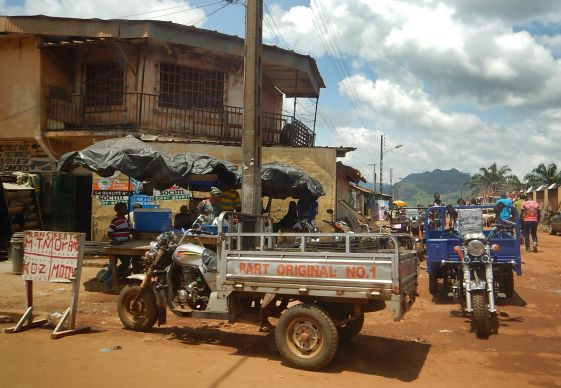 A motorcycle taxi awaits its next load in Man, Côte d'Ivoire. Photo by Isaac Broune, UMNS