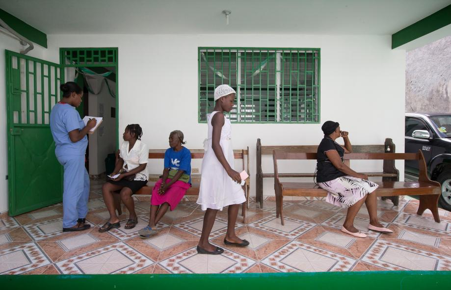 ​2014: Patients wait to be seen at the Haiti Eye Clinic in Petit-Goâve. The clinic is back in operation after being rededicated in January 2014.