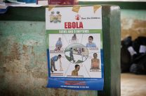 An educational poster about the dangers of the Ebola virus hangs in the community center at the Jaiama Bongor Chiefdom, outside Bo, Sierra Leone. The World Health Organization has declared the Ebola outbreak in West Africa an international health emergency.