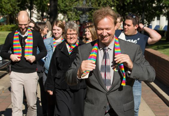 The Rev. Frank Schaefer (right) leads a procession of supporters from Court Square Park in Memphis, Tenn., on the way to his appearance before the United Methodist Judicial Council.
