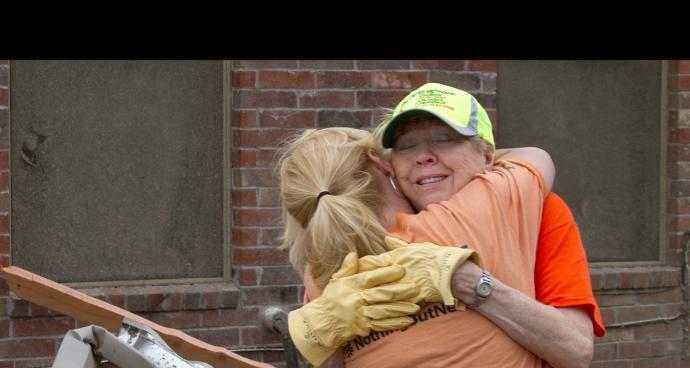 Ida Rose (right) receives a hug from Sheri Mathews, of the Arkansas Conference Disaster Response Team. File photo by Amy Forbus, Arkansas United Methodist Conference.