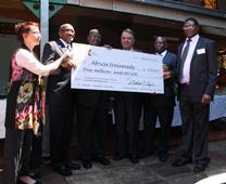 The Indiana Conference Delegation presents a ceremonial check to the leadership of Africa University. Photo by Vicki Brown, United Methodist Communications.