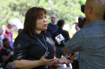 Bishop Minerva Carcaño speaks to the press during the immigration rally events in Washington on July 31, 2014.