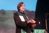 Bishop Elaine Stanovsky speaks about Sand Creek Massacre at the Rocky Mountain Annual Conference in Pueblo in June while holding a rock from Act of Repentance from the 2012 United Methodist General Conference.  Photo by Sam Hodges, UMNS