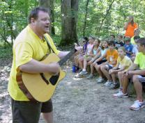 Will Penner leads a gospel song during worship at Cedar Crest Camp in Lyles, Tenn. Photo by Ronny Perry, UMNS.