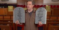 Chuck Knows Church holds stone tablets like the ones given to Moses by God with the Ten Commandments on them.