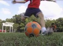 A child kicks a ball on the soccer fields of Seville Trinity United Methodist Church in Florida.