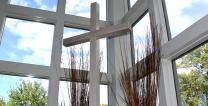 Cross in window. Photo by Kathryn Price.