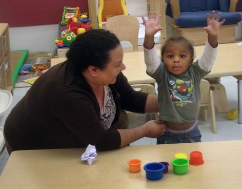 Sara Dominguez works in child care at Dallas Bethlehem Center, including supervising this exuberant 20-month-old. Photo by Sam Hodges, UMNS