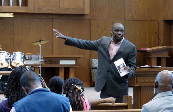 The Rev. Jacob Keega calls for maintaining faith in God during the Ebola threat. He preached Oct. 19 to the Heart of Africa Fellowship at Dallas' Lovers Lane United Methodist Church.