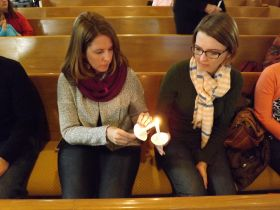 Nicole Hornbaker (left) and Megan Griffiths attend a prayer service for Dr. Martin Salia at Hanscom Park United Methodist Church in Omaha, Neb., Nov. 16. Salia, chief medical officer and surgeon at United Methodist Kissy Hospital in Freetown, Sierra Leone, died at Nebraska Medical Center Nov. 17 from Ebola.
