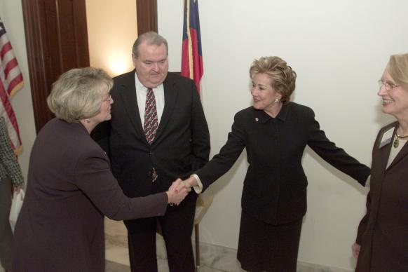 United Methodist Bishops Charlene Kammerer (left) and Marion Edwards greet U.S. Sen. Elizabeth Dole (R-N.C.) outside Dole's office during a visit by the Council of Bishops to Capitol Hill. Photo by Mike DuBose, UMNS