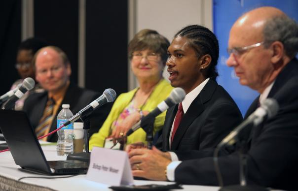 Krin Ali (second from right) responds to a question during a press conference on April 25 following the Episcopal, Laity and Young People's addresses to the 2012 General Conference in Tampa, Fla. Listening are (from left) Betty Spiwe Katiyo of Zimbabwe, Dr. Steve Furr, Jackson, Ala., Amory Peck, Bellingham, Wash., and Bishop Peter Weaver of the Boston Area of The United Methodist Church.