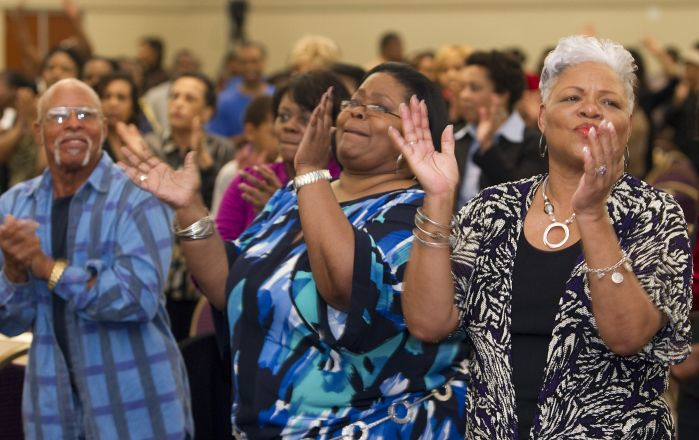 Worshipers sing during a Wednesday evening gathering at Kindgom Builders Center, Windsor Village United Methodist Church in Houston in this 2011 file photo. A UMNS photo by Mike DuBose.
