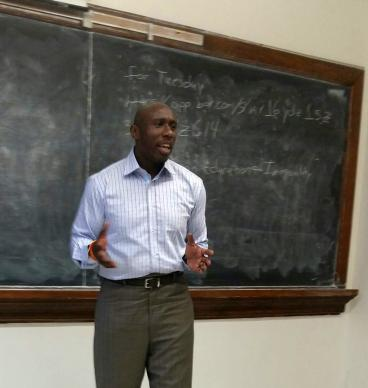 The Rev. F. Willis Johnson speaks at Howard University in Washington in an economic class where students did a case study on Ferguson. Photo courtesy of Akyiah Phillips