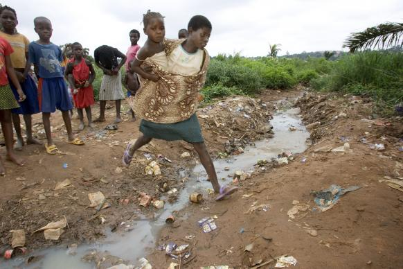 Children play alongside a sewage-filled ditch in the Maxinde neighborhood near Malanje, Angola. Leaders of The United Methodist Church are focusing the denomination's work around four areas of focus, including eradicating diseases of poverty around the world.