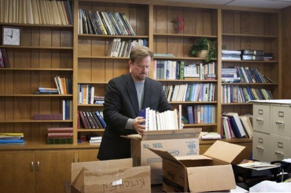 Frank Schaefer packs books as he leaves Zion Iona United Methodist Church after members of the congregation feted him at a farewell celebration on Jan. 5. Photo by Kathy L. Gilbert, UMNS.