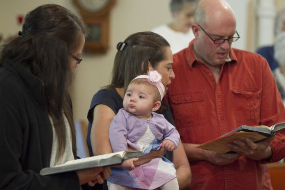 New life brings new hope at rural churches. Avery Guest, 6 months, keeps a watchful eye on Kati Thain during worship at Gilboa (Ohio) United Methodist Church. Photo by Mike DuBose, UMNS.