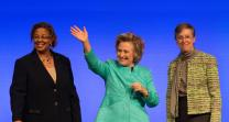 Hillary Rodham Clinton (center) waves to participants at the United Methodist Women's Assembly at the Kentucky International Convention Center in Louisville, Ky., following her address to the group. She is flanked by Yvette Richards (left) and Harriett Jane Olson of United Methodist Women.