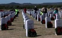 Volunteers place wreaths on every gravestone at Central Texas Veterans Cemetery at Killeen.