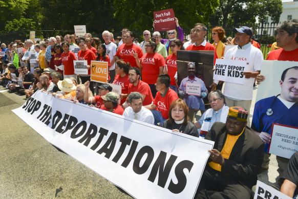 Faith leaders and immigration activists protest in front of the White House during a