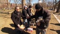 The Rev. Jerry Herships (left) shares sandwiches in ministry to the hungry and homeless as part of outreach of AfterHours Denver