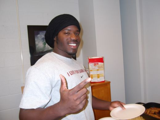 First generation student Keith Allen enjoys a pancake breakfast at Adrian College.