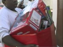 A shopper leaves with gifts from 61st Avenue United Methodist Church's Last Minute Toy Store. Video image courtesy of United Methodist Communications.