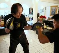 The Rev. Leo Fong does martial arts workouts every day.  Video image by Reed Galin.