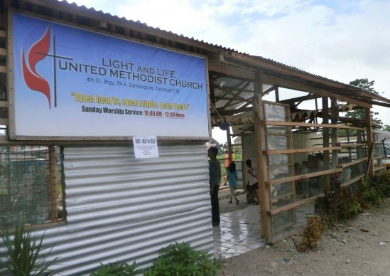 Light and Life United Methodist Church in Tacloban City, Philippines, is still housed in a temporary building a year after Typhoon Yolanda destroyed the previous sanctuary. Photo by Iris Terana and Geraldine Ayoste, UMNS