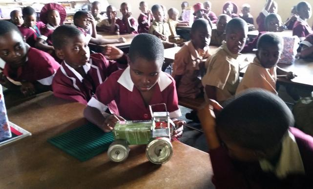 Accept Makamba, 9, uses her hands to feel a toy tractor at Murewa Central Primary School in Zimbabwe. She is the only visually handicapped pupil in her class. Photo by Eveline Chikwanah, UMNS.