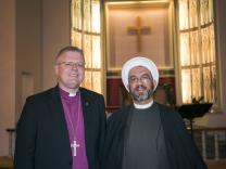 United Methodist Bishop Christian Alsted, Nordic and Baltic area, and Sheikh Mahmoud of the Tauheed Mosque, shown at a December meeting in Oslo, Norway, are convinced that interreligious dialogue is vital. Photo by Karl Anders Ellingsen, UMC Norway