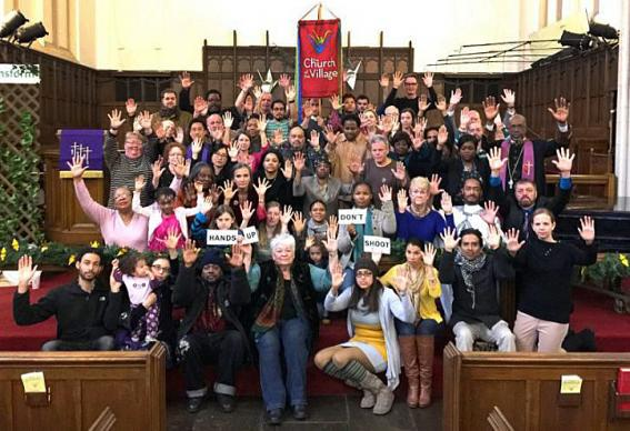 Members of Church of the Village, a multiethnic United Methodist congregation in Manhattan, join together after worship Nov. 30 in a show of solidarity with peaceful protesters in Ferguson, Mo. The church plans a prayer vigil at 5:30 p.m. ET Dec. 11.  Photo courtesy of Church of the Village