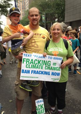 Tim Emmett-Rardin, left, holding his son, Gabriel, and Gerry Felix, members of Calvary United Methodist Church in Philadelphia, were among the United Methodists who traveled to New York Sept. 21 for the Peoples Climate March. Photo by Linda Bloom, UMNS