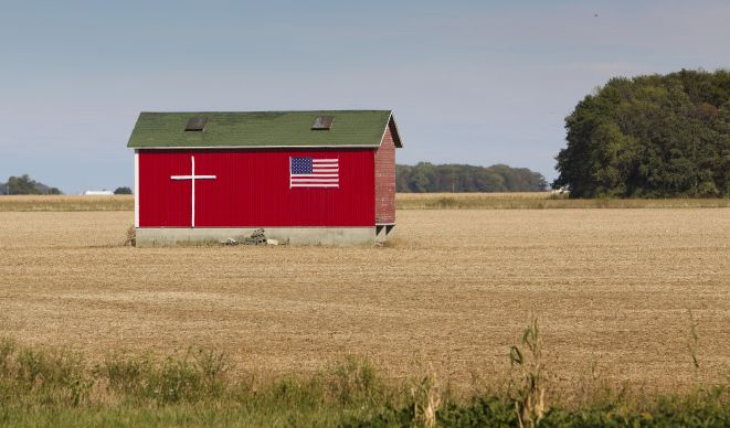 Symbols of God and country adorn a farm building near Van Wert, Ohio. Photo by Mike DuBose, UMNS.
