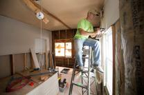United Methodist volunteer Ron Hilton installs drywall at a home that was flooded by Hurricane Sandy in the Sheepshead Bay area of Brooklyn in New York. Hilton is part of a volunteer team from Asheville, N.C.