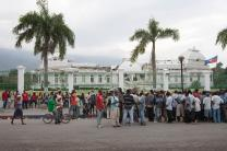 Residents of Port-au-Prince line up outside the devastated National Palace. A 2010 file photo by Mike DuBose.