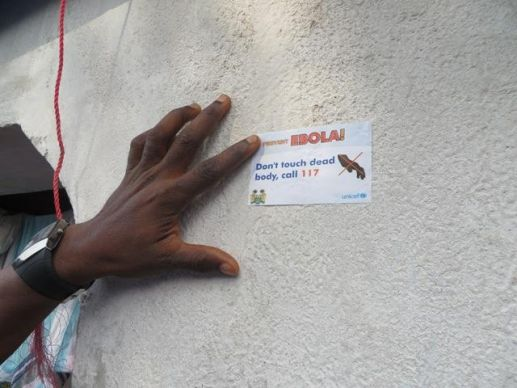 Volunteers placed stickers on buildings they visited to show contact had been made. Photo by Phileas Jusu