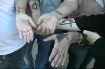Members of Wildwood United Methodist Church (Fla.) show off their faith tattoos. UMTV video image by Reed Galin.