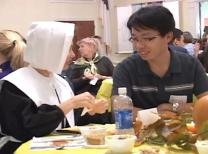 An international student eats a traditional Thanksgiving meal with members of Athens FUMC.