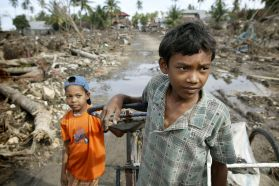 Two boys pick their way through debris-clogged streets in Banda Aceh, Indonesia. UMNS photo by Mike DuBose