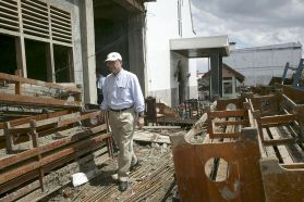 The Rev. Paul Dirdak, head of UMCOR, surveys the damage to the Methodist Church in Banda Aceh. A UMNS photo by Mike DuBose.